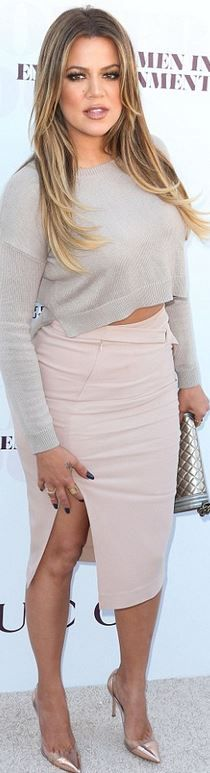Who made Khloe Kardashian's gray cropped sweater, silver handbag, cap toe clear pump, and pink slit skirt?