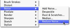 Selecting the Reduce Noise filter in Photoshop. Image © 2010 Photoshop Essentials.com