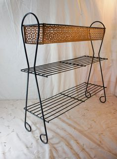 Metal stand mid century planter book shelf display atomic style black and gold plant stand wire Garden Rack, Gold Planter, Tall Shelves, Perforated Metal, Shelf Display, Mid Century House, Bookshelves, Mid-century Modern, Wire Racks