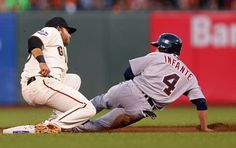 Omar Infante #4 of the Detroit Tigers is tagged out attempting to steal second base by Brandon Crawford #35 of the San Francisco Giants during the fourth inning of Game Two of the Major League Baseball World Series at AT & T Park on October 25, 2012 in San Francisco, California.