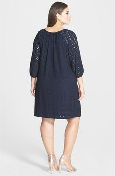 Free shipping and returns on London Times Keyhole Detail Eyelet Shift Dress (Plus Size) at Nordstrom.com. Pleats radiating from the flattering ballet neckline release soft dimension to a stylish shift dress crafted from jewel-toned eyelet. Banded three-quarter sleeves and a tantalizing front keyhole detail the charming design.