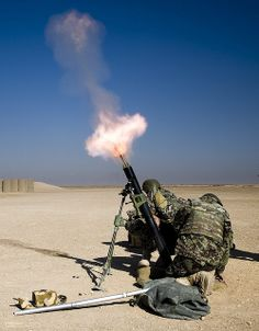 Soldiers of the Afghan National Army fire a mortar during a training course at Camp Bastion, Afghanistan. #OEF #Afghanistanwar