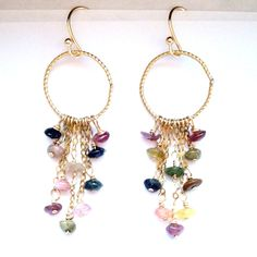 As stunning as the scales of a rainbow fish, these earrings inspire you to tell imaginative tales.