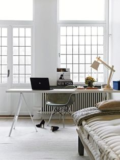 bedroom office:  love those windows (anyone else think it's weird that the desk faces INTO room + away from the windows?) // trestle desk // bed / French doors // task amp // chair