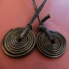 """Africa    Masaii, Brass Ear Coils   Worn over the head, hanging down as """"temporals"""" over the temples, in front of their ears, by Masaii women in Kenya.     ca. Mid 20th century"""