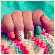 My nails, coral and teal with gold accent
