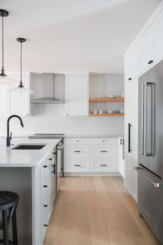 From Show Home to Style and Flow Rue light wood floors, white cabinets with black hardware, black kitchen faucet Wood Floor Kitchen, Kitchen Flooring, New Kitchen, Kitchens With Wood Floors, Basic Kitchen, White Shaker Cabinets, White Kitchen Cabinets, Kitchen Shelves, Black Kitchens