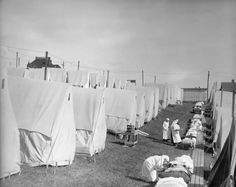Nurses care for victims of the 1918 Spanish influenza epidemic outdoors amidst canvas tents in Massachusetts. Researchers now say exposure to an earlier strain left people vulnerable to the pandemic strain, making it unusually effective. Missed In History, Flu Epidemic, Canvas Tent, Nursing Care, The Weather Channel, Historian, Historical Photos, National Geographic, First World