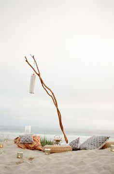Have similar Beach set-up ♥...branches decor cushions, our anniversary cake, bucket of ice with beverages