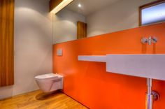 Browse modern bathroom designs and decorating ideas. Discover inspiration for your minimalist bathroom remodel, including vanities, cabinets, mirrors, faucets room decor projects for a taste of magic bathroom ideas Modern Bathroom Colours, Orange Bathrooms, Modern Bathroom, Wall Mounted Toilet, Interior, Painting Bathroom, New Toilet, Room Paint, Modern Bathroom Design