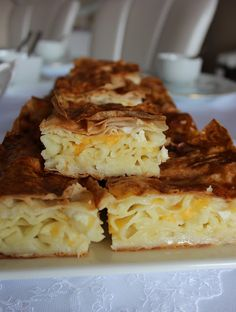 Makarnalı Börek (Turkish) - noodle Pastry Ingredients:     4 yufka 1 cup melted butter or vegetable oil (I used butter) 4 eggs (yolks and whites separated) 3 cups milk Butterfly pasta 1 package Pastavilla Cheddar and feta cheese for domestic Also to add on için1-2 piece of butter