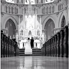Traditional Catholic wedding... Beautiful couples shot after the ceremony. Could also look really neat with the guests seated in the shot, as well as empty pews.