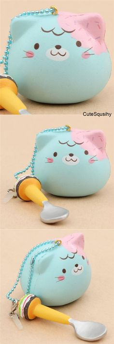 Kawaii teal cat squishy with strawberry dripping sauce!