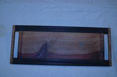 inlayed madrone w/ walnut edges and mapleburl handles.  2012