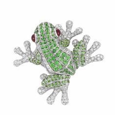 White Gold, Green Garnet and Cabochon Ruby Frog Brooch   The frog embellished by round green garnets, its body and feet pave-set with 315 round diamonds approximately 6.70 cts., accented by 2 round cabochon ruby eyes, approximately 12.3 dwts.