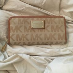 Michael Kors Wallet Never used but some minor scratching on gold faceplate from storage. Authentic MK wallet! Matches purse I also have listed. Michael Kors Bags Wallets