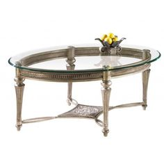 @Overstock.com - Galloway Oval Cocktail Table w/ Glass Top - The elegant look of this glass-top oval cocktail table makes an eye-catching addition to any room or decor. The tapered legs and brushed-pewter finish of this table adds classic style to your atmosphere while providing convenient storage space.  http://www.overstock.com/Home-Garden/Galloway-Oval-Cocktail-Table-w-Glass-Top/8033237/product.html?CID=214117 $359.99