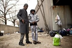 Linwood Hearne, 64, and his wife, Evelyn, 47, stand near Interstate 83 in Baltimore where they have slept on and off for the past four years. According to the local nonprofit Health Care for the Homeless (HCH), a growing percentage of homeless patients nationally are 50 or older, with complex mental and physical conditions.
