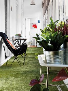 Fun artificial grass flooring for a sunroom. Would be really fun to have a grass floor in a playroom. However I am not sure how comfortable it is to play on, or how easy it is to keep clean...