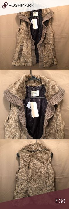 Faux fur vest. New with tags! Stylish faux fur vest! No closure...just throw it on and go! Fully lined. Two functional pockets. Great for winter! Ashley By 26 International Jackets & Coats Vests