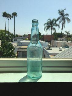 Antique Light Blue-Aqua Glass Bottle; Antique Beer Bottle; Mouth-Blown Glass Bottle; Glass Bottle Decor; Glass Bottle; Bottle Flower Vase #GlassBottle #AntiqueBeerBottle #MouthBlownBottle #LightBlueBottle #AquaGlassBottle #BottleFlowerVase #GlassBottleDecor #HandmadeBottle #AntiqueGlassBottle #CollectibleBottle