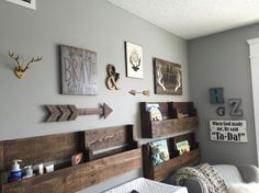 Baby boy nursery collage. Antlers, bravery quotes, and arrows. Grays and neutral colors with wood and pops of metal.