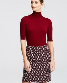 Cast in an array of rich fall colors, this wardrobe essential flatters with the fit of a second skin. Team with slim fit styles in striking shades and prints for a look that goes for bold. Turtleneck. Short sleeves. Ribbed neck, cuffs and hem.
