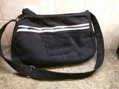 June 2015 large corduroy black carry on bag lots of zippers adjustable strap view 1