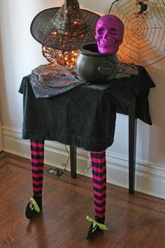 My trick-or-treat table is all ready for neighborhood ghouls and goblins. I created this witch legs Halloween table to sit in our entry way to hold our treats for Halloween night. Creating it was su