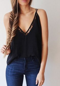 With the scorching heat of the sun, it's obvious that you should wear breezy clothing, like this sexy black plunge strappy cami top.