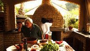 Chef Celestino Drago's outdoor kitchen in Sherman Oaks  Celestino Drago, the chef behind four restaurants, a bakery and a catering operation, has an impressive indoor kitchen at home, but it's the outdoor kitchen with beehive wood-burning oven that he truly loves. The setting? Like cooking in the Italian countryside.  http://www.latimes.com/la-hm-celestino-drago-kitchen-photos-photogallery.html