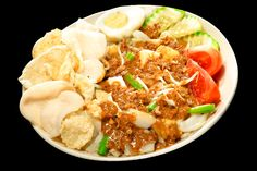 Gado Gado - Indonesian fresh salad with peanut dressing. Best when served with shrimp chips!