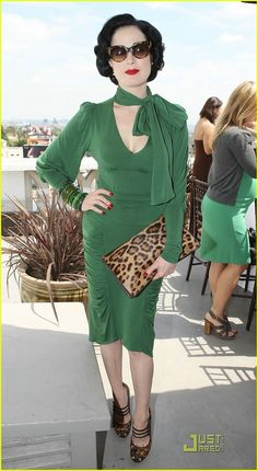 Dita Von Teese in a green silk jersey dress. So pretty.