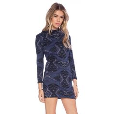 POSHFEST SALE!🌟Free People Cutout Bodycon Dress🌟 Fabulous and Cozy Long Sleeved Free People Printed Bodycon is Perfect all the way from the office with a pair of cute pumps to an evening on the town with your fave boots! Mock Neck with a little sexy cut out back! 97 cotton 2% poly 1% spandex for a super figure flattering fit that is non wrinkling and completely machine washable. Fully lined in 100% Rayon Free People Dresses
