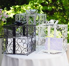 LOVE these Reception Gift Card Holders ... they keep all your wedding day wishes and gifts wrapped up in high style. Available in black, white, or glittery silver!