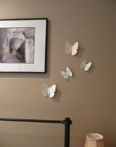 Paper Butterfly Wall Art. Do with some old sheet music and it looks great! <3