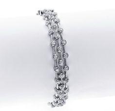 Gordon James Triple Row Bracelet with 5.18 carat total weight in Round Brilliant Cut Diamonds. Set in 18k white gold. http://www.gordonjamesdiamonds.com/products/diamond-bracelets/b-2077