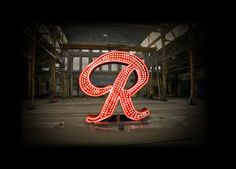"Celebrate the return of the Rainier Beer ""R"" sign to the top of the Old Rainier Brewery on Oct 22 & 24th, 2013."