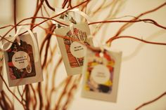 Comic book escort cards on twig branches - Wedding at Room 1520. Photography by Jack Klobetanz
