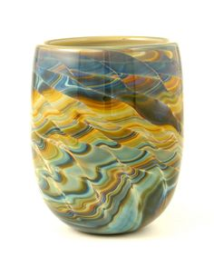This bowl was blown from calcedonio (silver) glass by Jeff Price in his studio.