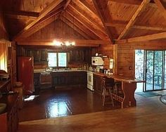 Cornwall, a town that oozes New England charm, is the location for this log home nestled within more than five acres of woodlands. This home packs in quite a lot of space, offering five bedrooms and three bathrooms, spacious kitchen, and living room with cathedral ceiling and a massive stone fireplace that just begs for being gathered around with friends and family. The house is sited on a bucolic setting that includes a rumbling brook.