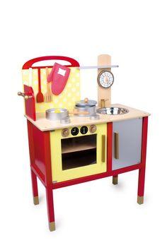 """Küche """"Denise"""". Hier kommt die Profiküche für's Kinderzimmer! Wunderschöne Küche aus bunt lackiertem Massiv- und Schichtholz. Altersgerecht bietet die Küche eine kleine Lernuhr, einen Topf und einen Pfanne mit Spiegelei aus Holz und 3 Küchenhelfern. Genau wie bei den Großen! Die Drehknöpfe am Herd sind beweglich und klicken beim Drehen. Magnete halten die Utensilien und die niedlichen Topfhandschuhe an ihrem Platz."""