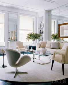 In the living room of fashion designer Gilles Mendel's Paris home, mink upholstery (SERIOUSLY?) on an Arne Jacobsen Swan chair—and matching fur pillows—pay homage to his family's couture fur business, J. Living Room Designs, Living Room Decor, Living Spaces, Living Rooms, Small Living, Modern Living, Poltrona Swan, Swan Chair, Decoracion Vintage Chic
