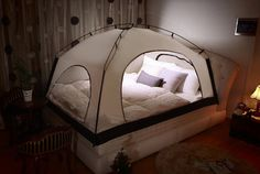A cozy tent just for their bed.