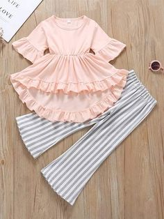 Toddler Girls Ruffle High Low Dress With Striped Flare Pants - - Toddler Girls Ruffle High Low Dress With Striped Flare Pants Ropa para niñas fashion Girls Dresses Sewing, Stylish Dresses For Girls, Frocks For Girls, Toddler Girl Dresses, Little Girl Dresses, Toddler Girl Clothing, Baby Dresses, Toddler Outfits, Kids Clothing