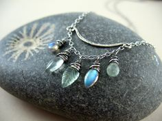 Watery hues in labradorite, green amathyst, carved fluorite, and aquamarine.  Sterling silver.