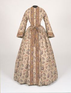 Philadelphia Museum of Art - Collections Object : Woman's Dressing Gown: women's wrapper: Straight, full fronts that is cut wide on the back but still fitted on the shoulders. Usually Belted and worn open to show petticoat underneath.