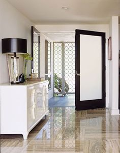 White with black trim, and interesting geometric shapes on the wall.