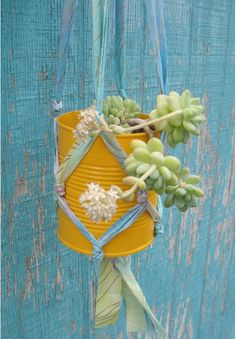 plant hanger from fabric straps and a can