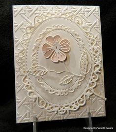 handmade card ... gorgeous layers of Spellbinders embossing and die cutting ... luv all of that texture ... flower with skeleton leave as focal point on center oval ...